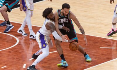 Wesley Matthews and Kyle Anderson struggle for a loose ball.